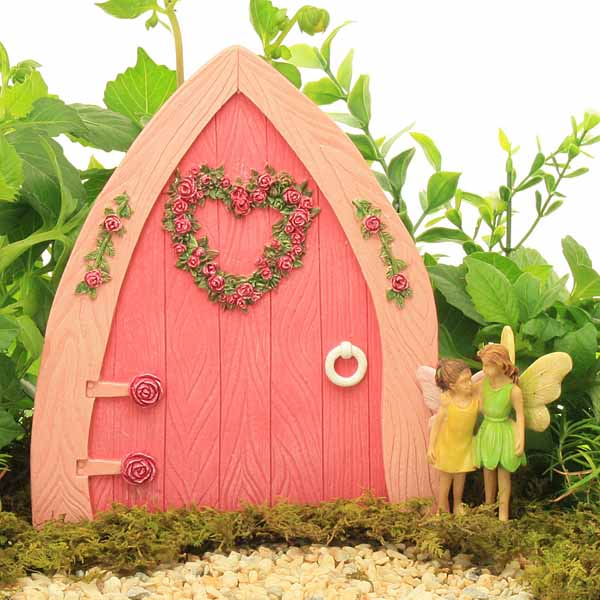 Large resin pointed fairy door rosebud heart wreath pink for Large gnome doors