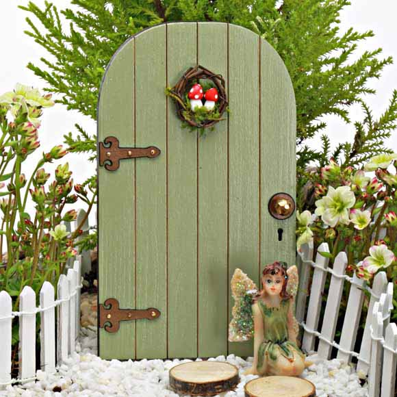 Fairy door with mushroom wreath the fairy garden for Outdoor fairy door