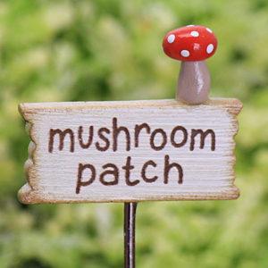 This mushroom patch miniature sign has a tiny little handmade mushroom
