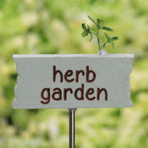 This herb garden miniature sign has a tiny little sprig of herbs