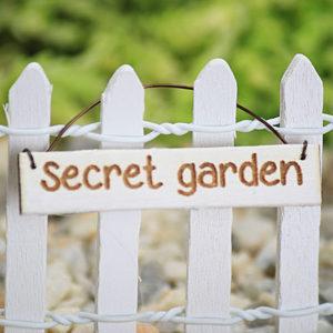 secet garden handing sign