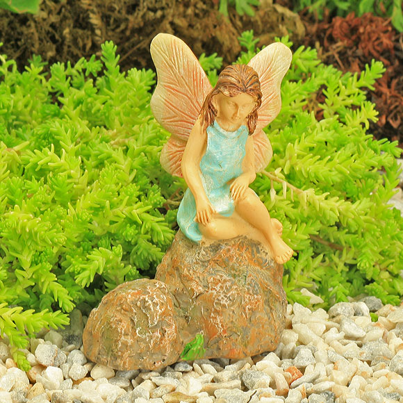Sitting Blue Fairy on Rock